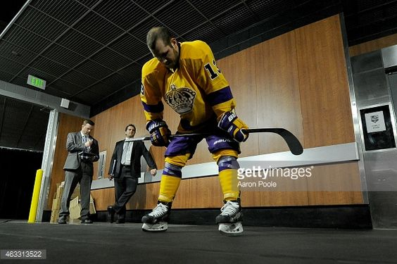 LOS ANGELES, CA - FEBRUARY 12: Kyle Clifford #13 of the Los Angeles Kings stands outside of the locker room before warm-ups before a game against the Calgary Flames at STAPLES Center on February 12, 2015 in Los Angeles, California. (Photo by Aaron Poole/NHLI via Getty Images)