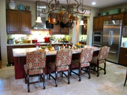 I don't like the big chairs, but I love the pot racks and pot collection above cabinets
