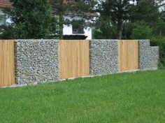gabion fence with vertical timber pailings http://www.gabion1.com