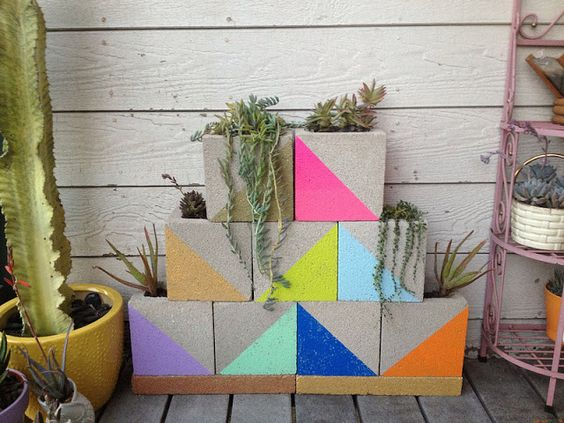 Geometric planters... Awesome diy painted outdoor planters made from cinder blocks. Totally cheap budget idea! But way cool.