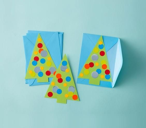 Trace trees on construction paper, cut them out, and decorate with stickers from the office supply store. (Great DIY project for kids!)