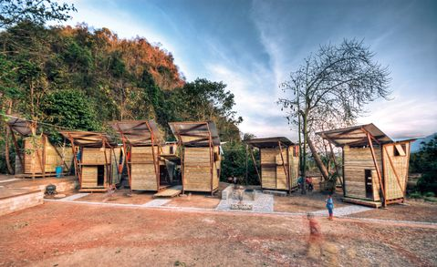 This is awesome: two Norwegian architecture students spent a year designing and building a series of houses, a library and a bathhouse for orphans along the Thailand-Burma border -- and as a result, the locals have now started adopting their construction methods for their own homes.