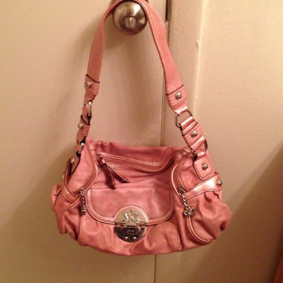 Authentic Pink Kathy Zeeland Handbag Cute pinkish color purse. Suede material. Very good cond. It's very slightly stained because it was in a tote. Kathy Zeeland Bags