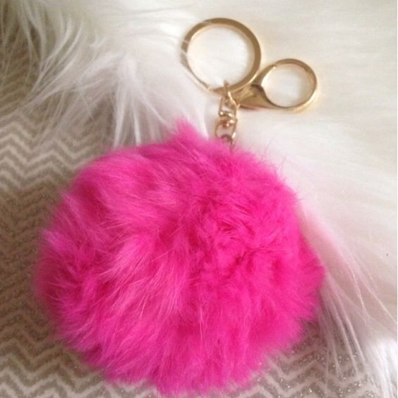 Hot Pink Pom Pom Keychain New in package! Rabbit fur with gold tone keychain. I have lots of reviews on these, check them out! Colors I have: hot pink, light pink, red, gray, turquoise, navy blue, cobalt blue, green & white. Price is firm unless bundled. 10%OFF 2+ Accessories Key & Card Holders