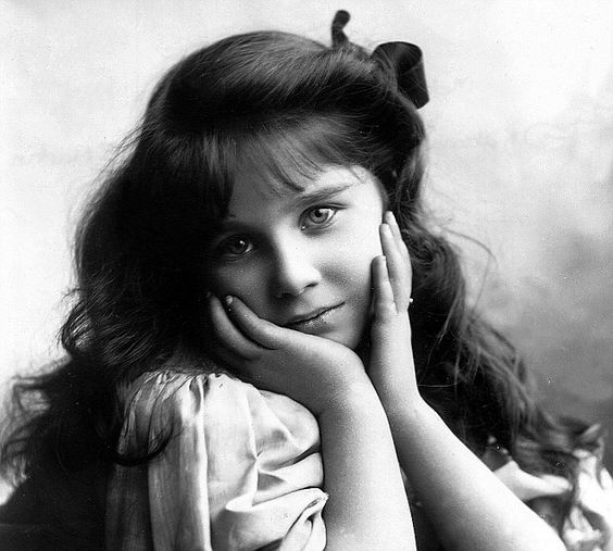 The late Queen Mother of England, Elizabeth Bowes Lyon, at age 7, in 1907.  Such a pretty girl.