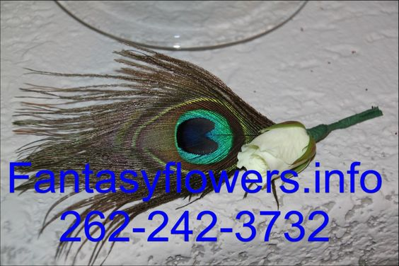 Feathers are hot this year.  Peacock feathers are great for dresss that are green or blue or even pink colors