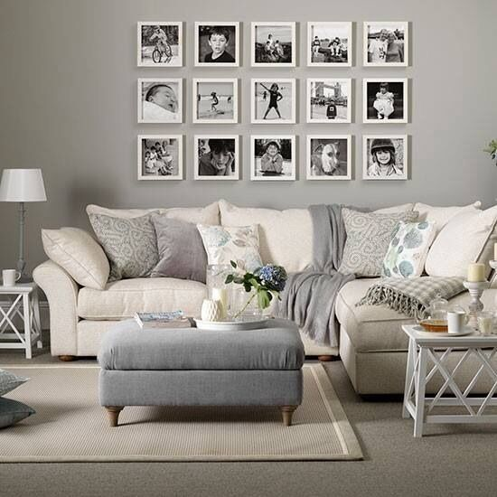 A lounge room of greys and creams, black and white prints: