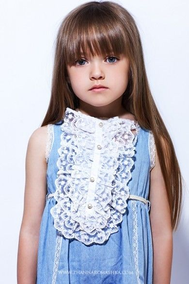 young girl in blue