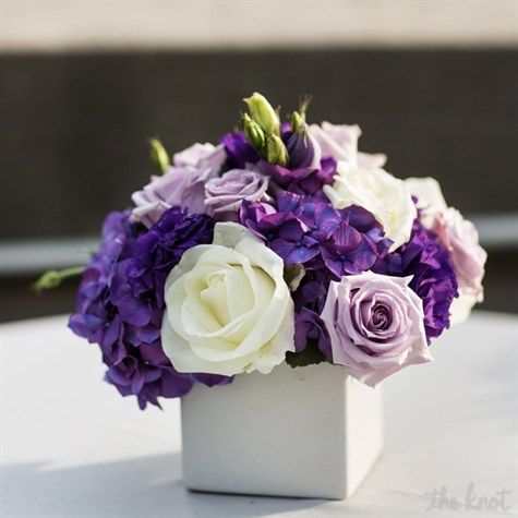 Purple and White Centerpieces - like the colors and the flowers, but would need to be bigger and less compact, and with mercury holder