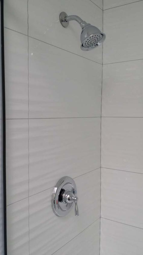 Wavy White Tiles In Shower Grey Grout Bathroom Shower Walls Tile Bathroom White Tile Shower