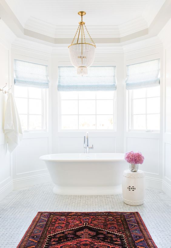 Marble basketweave tile, Persian Rug in the bathroom and chandelier over tub || Studio McGee:
