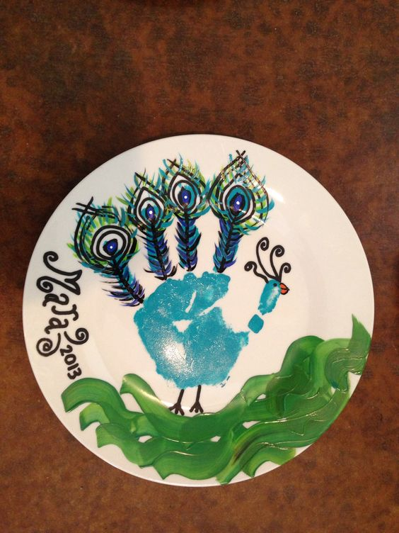 Peacocks and plates on pinterest for Handprint ceramic plate ideas