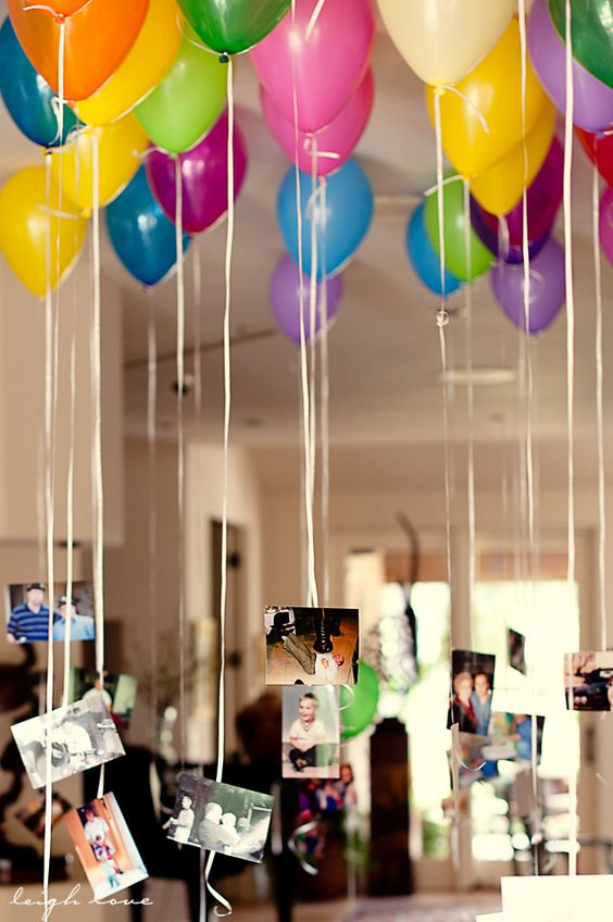 It would be neat to have navy and yellow balloons filling the ceiling of the foyer where the guest book is