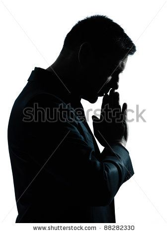 one caucasian business man thinking praying portrait silhouette in studio isolated on white background - stock