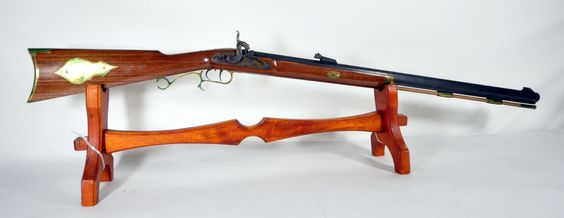 """Thompson Center Arms Hawkin Black Powder Rifle .50 Cal. These muzzle-loader black powder rifles feature a traditional cap-lock design. Also featuring hooked breech system, adjustable triggers, 28"""" blued octagonal barrels, & American Walnut stock with brass accents. $250.00"""