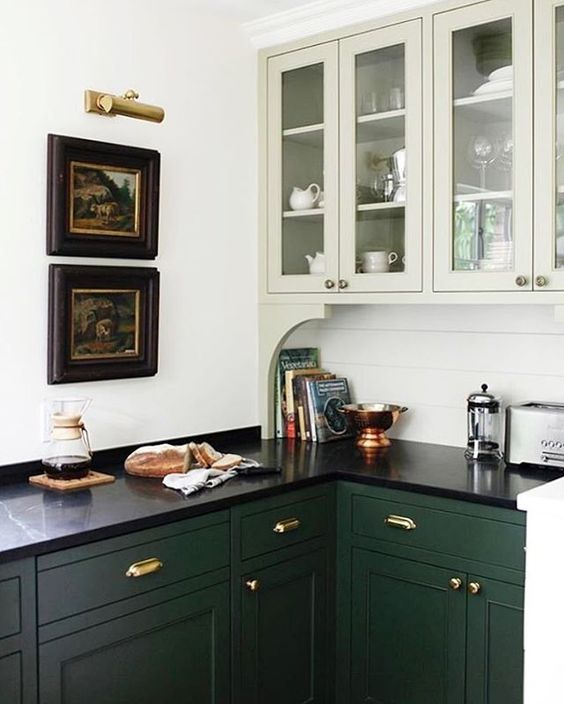 dark green cabinets with black countertop