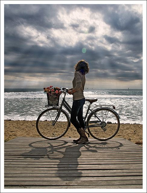 bike and sea. would like it too be me one day - but less thin.