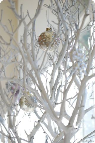 Branches sprayed white and decorated with christmas ornaments