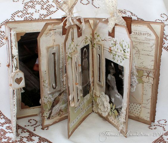 Hi, Theresa here with my second A Day in May project!I made a mini album with some old photos of my daughter.Thank you Marianne for the lovely flowers!The letter decorations are made with paper clay and very old foamstamps ;)Love to play with thread and pearls...Many thanks for…: