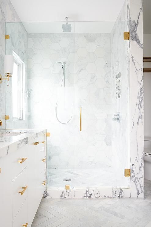 Luxurious Bathroom Design Boasts A Large Walk In Shower With A Gray And White Marble Threshold And B White Marble Bathrooms White Marble Shower Bathroom Design