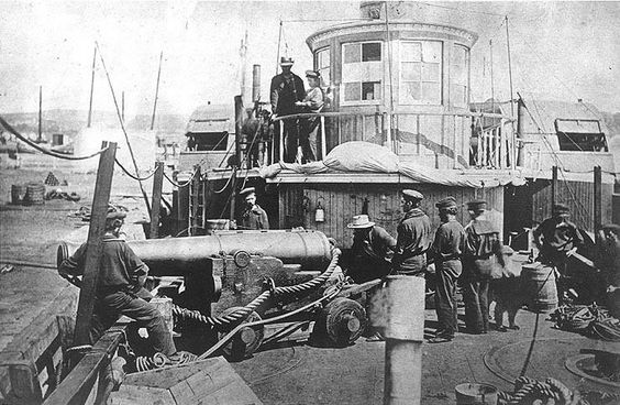 """Thomas Meagher The American Civil War . The steam tug USS Thomas Freeborn in 1861. The photo shows some of the ship's officers and men demonstrating how her late commanding officer, Commander James H. Ward, was sighting her bow gun when he was mortally wounded on 27 June 1861, during an action with Confederate forces at Mathias Point, Virginia. The gun is a 32 pounder smoothbore, of 60 hundredweight, on a """"Novelty Carriage"""". This mounting was developed by Commander Ward before the Civil…"""