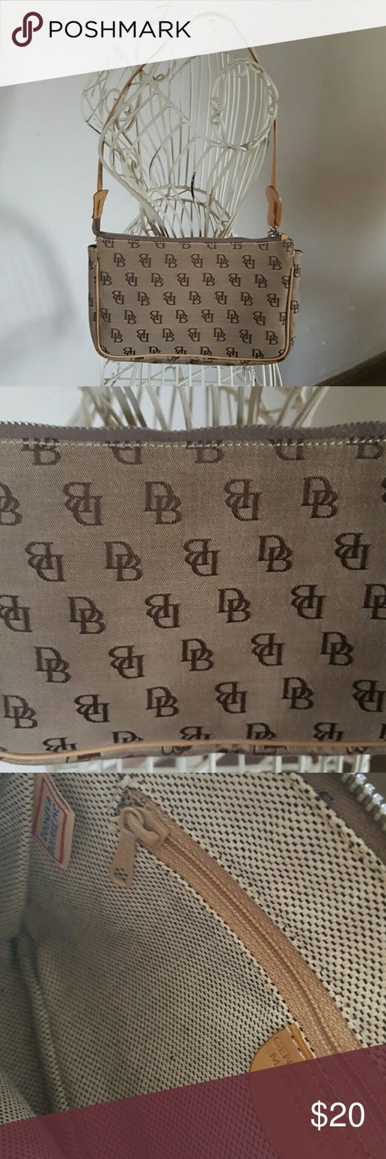 Vintage Dooney & Bourke Canvas mini purse Authentic Vintage Dooney & Bourke Canvas mini purse, leather made in Italy, style is 819, tan with brown pattern, 9 1/2in in width, 6in in height, hardly used! Dooney & Bourke Bags Mini Bags
