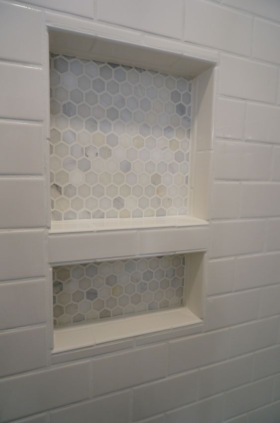 HomeARCH Renovations. Tiled Shower Niche. Carrara hexagon tile.: