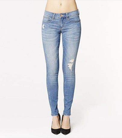 Casual and sexy! This medium wash distressed skinny looks fun and flirty paired with one of our graphic tees and a blazer.