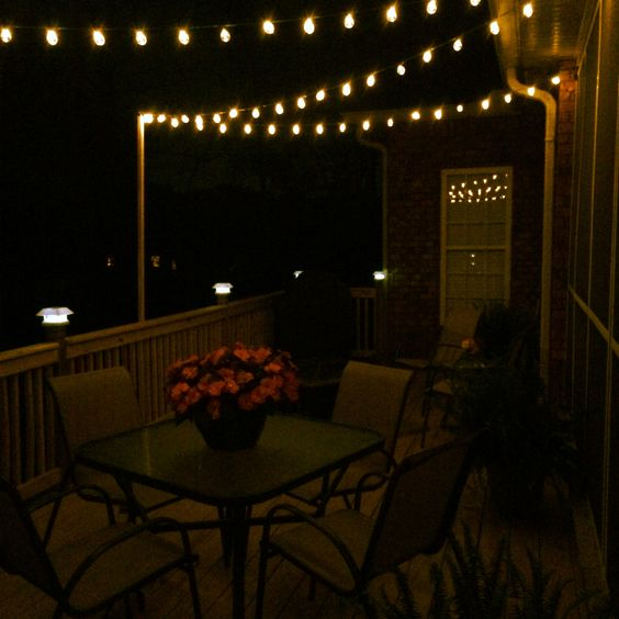 diy deck lighting using wooden poles and s hooks porch