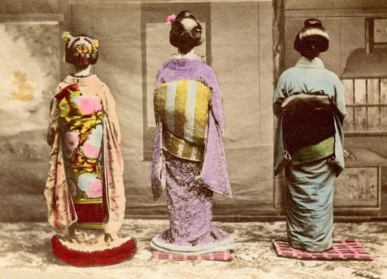 https://flic.kr/p/cTek7L | Dressed for Shubun-no-hi 1890s | From left to right, a Maiko (Apprentice Geisha), a Junior Geiko (Geisha), and a Geiko (Geisha), dressed in fine clothing, probably to celebrate Shubun-no-hi (Autumn Equinox) given the Autumn motifs on the Maiko's obi (sash).  The Maiko is wearing a musubi (knot) variation to her traditional Darari Obi (Dangling Sash) which appears to have only one panel hanging down, with the other one tucked underneath, the end folded above one sho...: