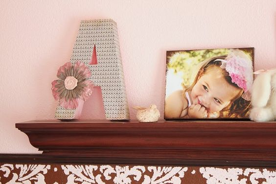 Make your own canvas photos with mod podge and scrapbook paper.