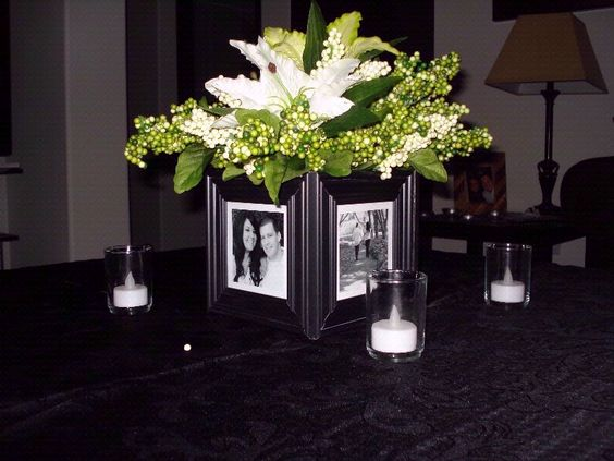 Glue dollar store frames around a cube vase. Pictures of graduate at different ages, the bride and groom, mom and dad through the years for an anniversary party. The possibilities are endless.