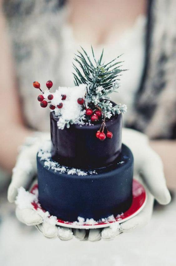 a navy blue cake for a winter wedding