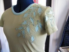 This has the Alabama Chanin look. Reverse Applique Tshirt upcycle