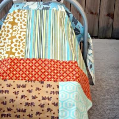 Infant car seat blanket. Perfect for covering them up and not chasing that blanket down the sidewalk when the wind catches hold of it.