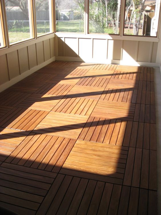 Love the floor and the screen for that awkward back porch for Covered porch flooring options