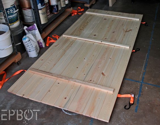 There are several ways to make a simple plank door. We used exterior tongue-and-groove board normally used for house siding: