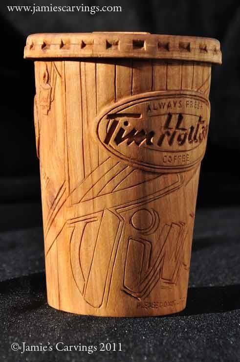 Tim hortons coffee cup sculpture hand carved by acadian
