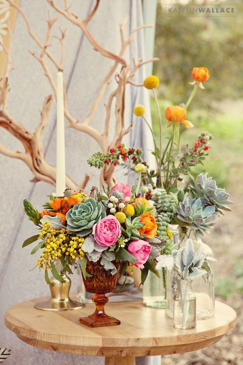 Love the assortment of vases found vintage rentals