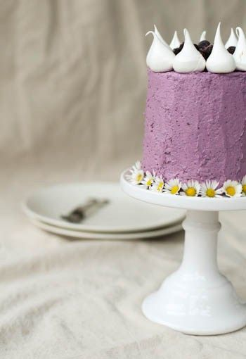 Luscious Birthday Cake with cardamom cake layers and magnificent Blueberry Swiss Meringue Buttercream Frosting crowned with fresh blueberries and meringues!