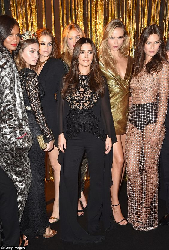 A flare for fashion: Cheryl's trousers trailed behind her...