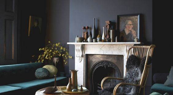 The idea of painting a wall black, let alone any dark color, can send some people running for the hills. It might strike some as counter to any good decorative advice—wouldn't dark walls make a room look smaller, colder, possibly more depressing?...