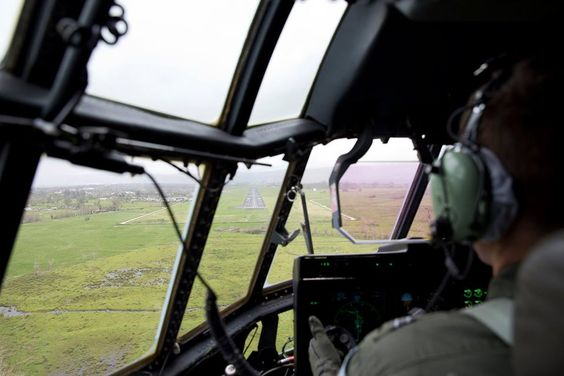 A Royal Australian Air Force C130-J Hercules pilot looks over the runway at Vanuatu's international airport before delivering emergency relief supplies and Australian Defence Force and Department of Foreign Affairs and Trade personnel on 15 March 2015.