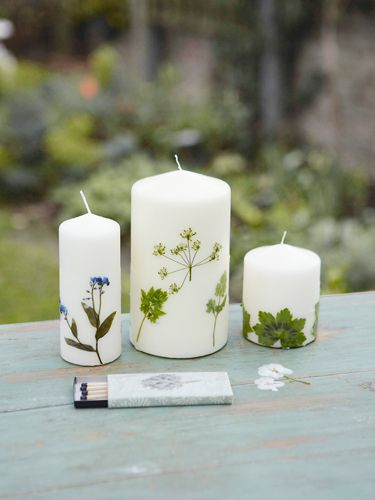 Botanical Candles - and instructions on how to preserve flowers and herbs for holiday gift crafting from Country Living.