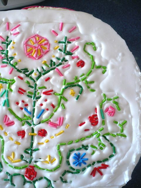 Embroidery-style cake decorating with sprinkles.
