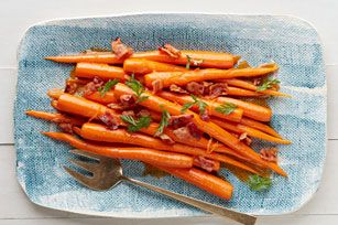 Next time you see beautiful fresh carrots with tops at the farmers' market—grab 'em! And make this beautiful side dish with crumbled bacon and orange zest.