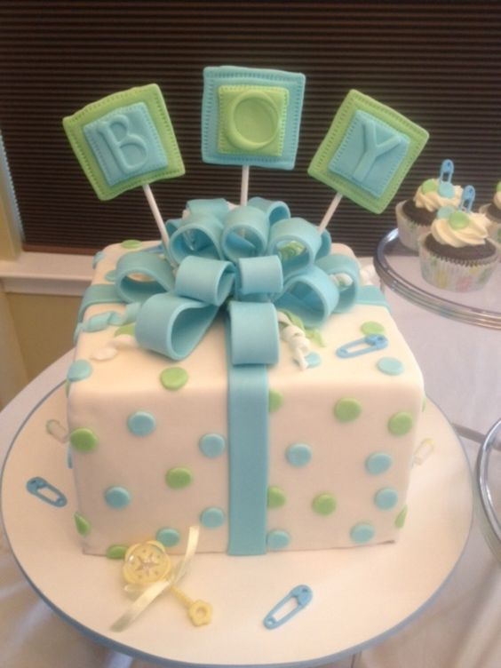 Baby Shower celebration cake with matching cupcakes: