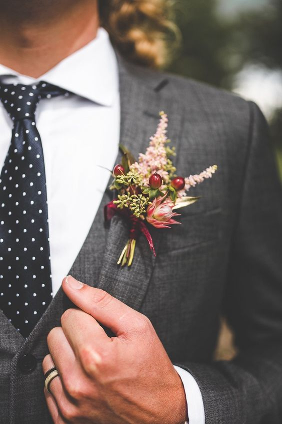 Charming boutonniere of pinks and crimsons - perfect for a fall or winter wedding | Xandra Photography