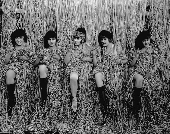 """April 24, 1918, Los Angeles: Some of the """"Bathing Beauties"""" from Mack Sennett's Keystone Studios surrounded by a curtain of confetti streamers."""