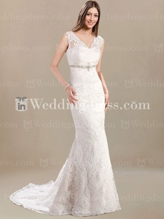 Mermaid style wedding dress has glamorous appeal. Bodice features eye-catching illusion V-neckline.